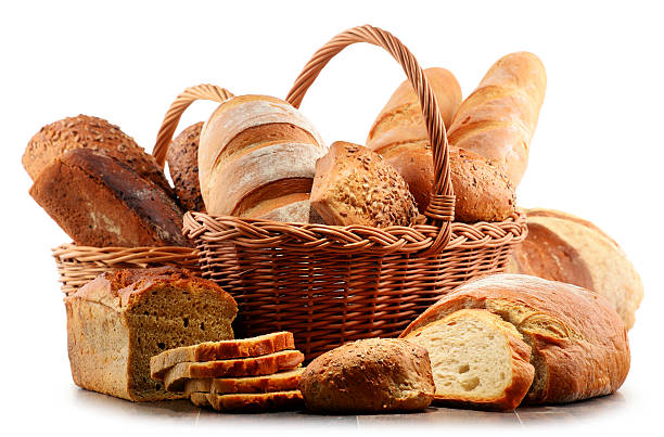 Wicker basket with assorted baking products isolated on white Wicker basket with assorted baking products isolated on white background bread stock pictures, royalty-free photos & images