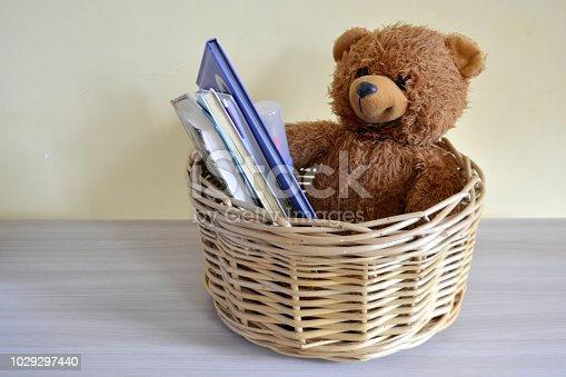 wicker basket with books and toy Organization and storage of things in the house
