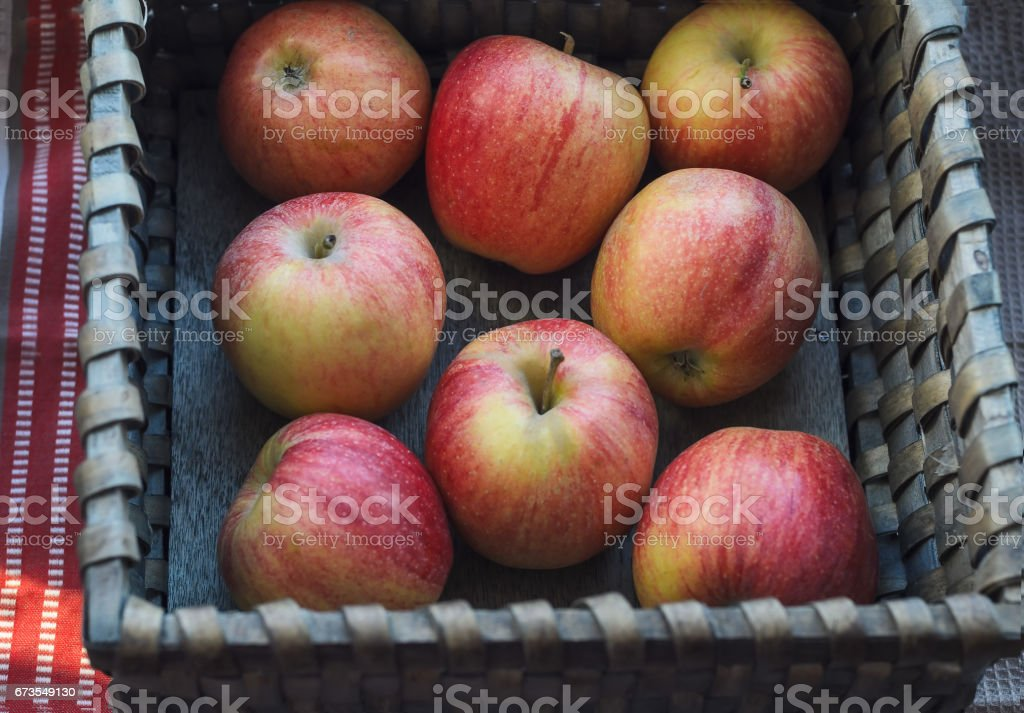 Wicker basket with fresh apples royalty-free stock photo