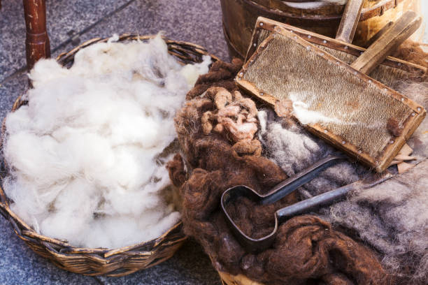 wicker basket with virgin wool - wool stock photos and pictures