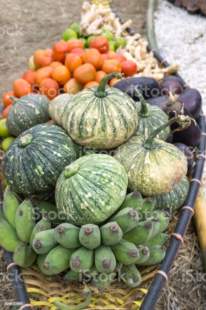Wicker boat carrying fruit and vegetable stock photo