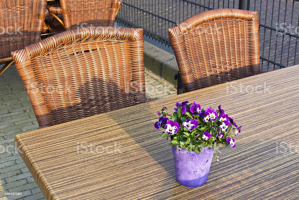 Wicker cafe tables and chairs royalty-free stock photo