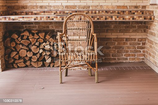 istock wicker chair stands on autumn veranda. 1030310378