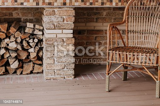 istock wicker chair stands on autumn veranda. 1043744974