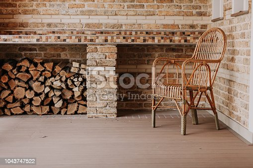 istock wicker chair stands on autumn veranda. 1043747522