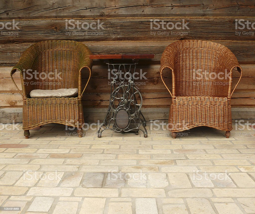 Wicker chairs and antique table royalty-free stock photo