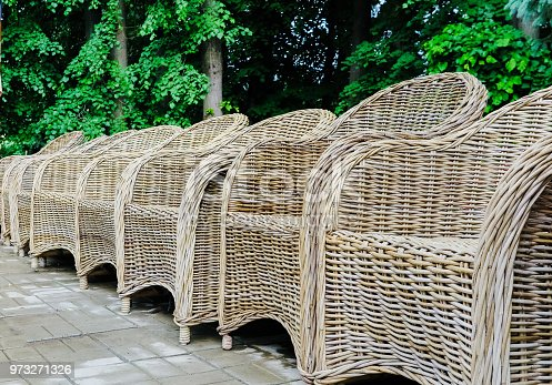 istock wicker chairs in a row in the park 973271326