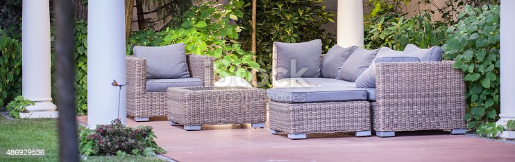 istock Wicker furniture on patio 486929536