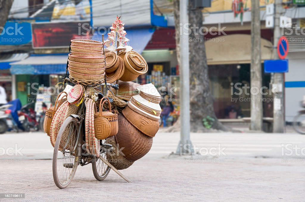 Wicker Hat And Basket Mobile Bicycle Shop In Hanoi, Vietnam royalty-free stock photo