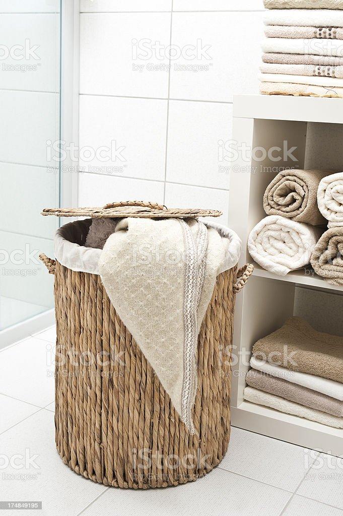 Wicker Laundry basket in the Bath stock photo
