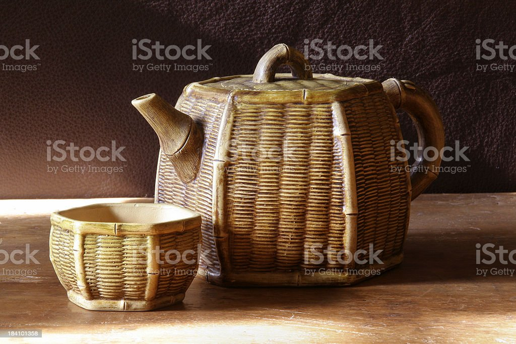Wicker Like Teapot with Cup royalty-free stock photo