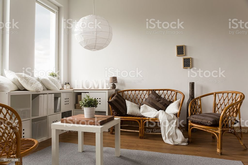 Wicker loveseat and chairs stock photo