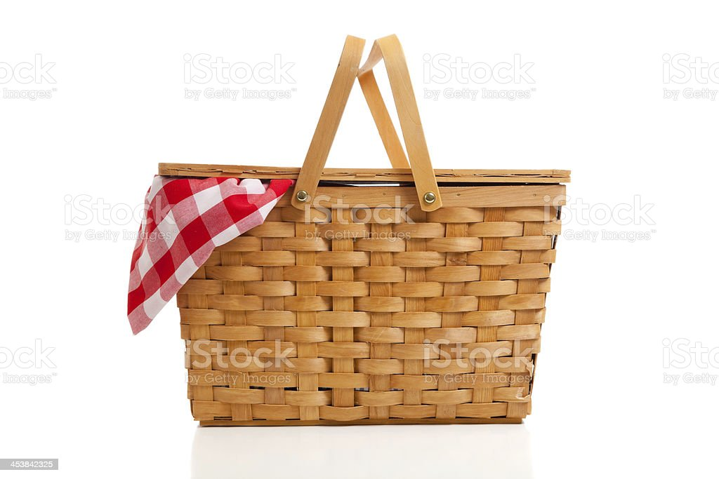 Wicker Picnic Basket with Gingham Cloth stock photo