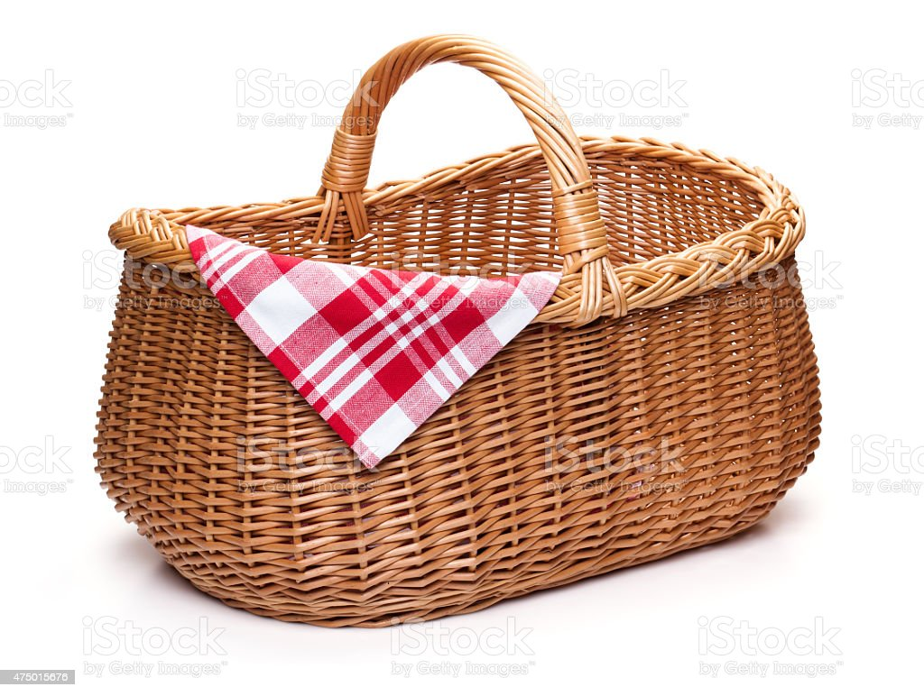 Wicker picnic basket with red checked napkin. stock photo