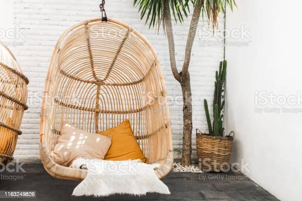 Wicker rattan hanging chair in loft cafe eco friendly furniture style picture id1163249826?b=1&k=6&m=1163249826&s=612x612&h=2iwu 8k7eplbtzk8fztzs5f7cyi2lkfobrqijj4vbru=