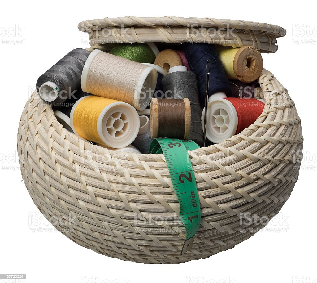 Wicker round box with accessories for needlework. stock photo