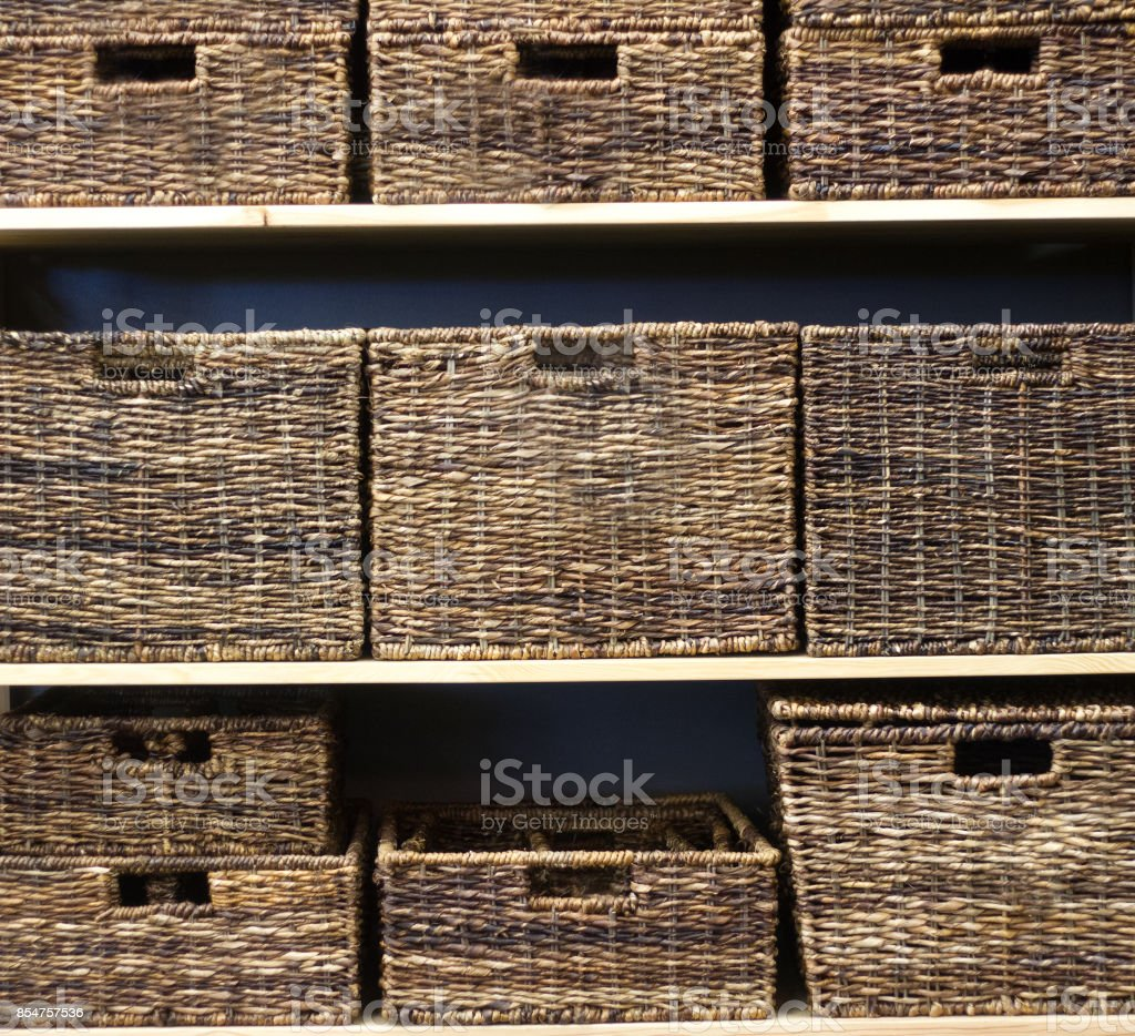 Wicker Storage Baskets Neatly Stacked On Shelves Royalty Free Stock Photo