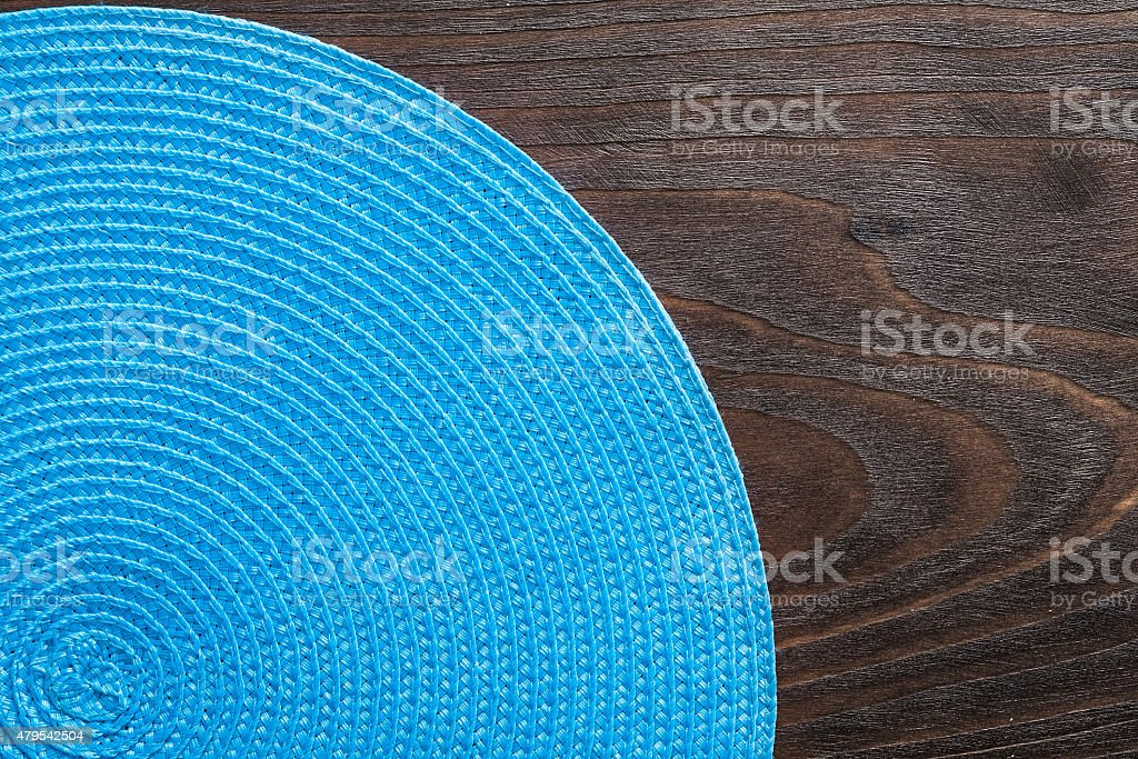 wickered round mat on vintage wooden board stock photo