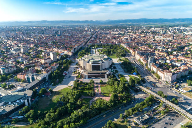Wide aerial drone shot of national palace of culture in Sofia city downtown district Wide aerial drone shot of national palace of culture in Sofia city downtown district. The picture was taken near sunset with DJI Phantom 4 Pro drone / quadcopter. bulgaria stock pictures, royalty-free photos & images