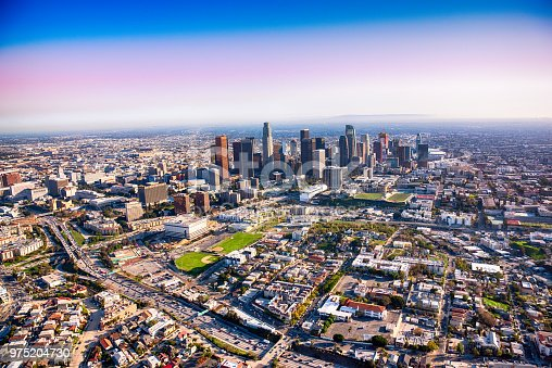 The downtown and surrounding neighborhoods of the city of Los Angeles, California shot nearing dusk from an altitude of about 1500 feet.