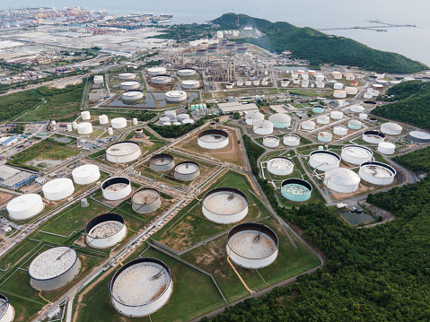 Wide angle aerial view in day time of oil refinery industry in day time. Petrochemical plant and storage tank in large industry