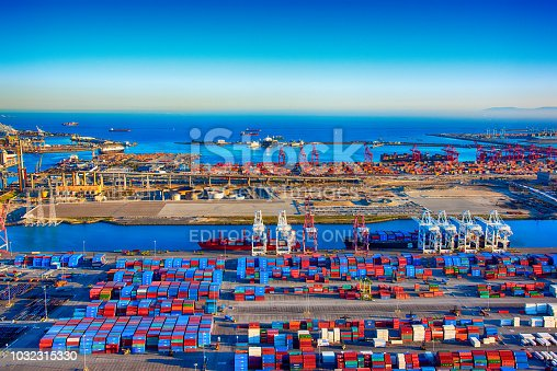 San Pedro, United States - March 28, 2018:  Ships, containers, and railways at the Port of Los Angeles, California; the busiest seaport on the west coast of the United States,  shot wide angle from an altitude of about 1500 feet during a helicopter photo flight.
