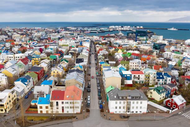 Wide angle cityscape of Reykjavik, Iceland Wide angle view of Reykjavik from Hallgrimskirkja, Iceland Hallgrímskirkja church stock pictures, royalty-free photos & images