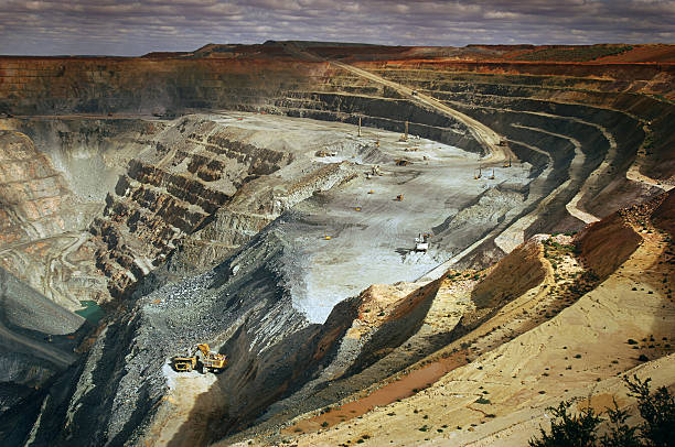 wide angle elevated view of an open cut mine. - gold mine stock photos and pictures