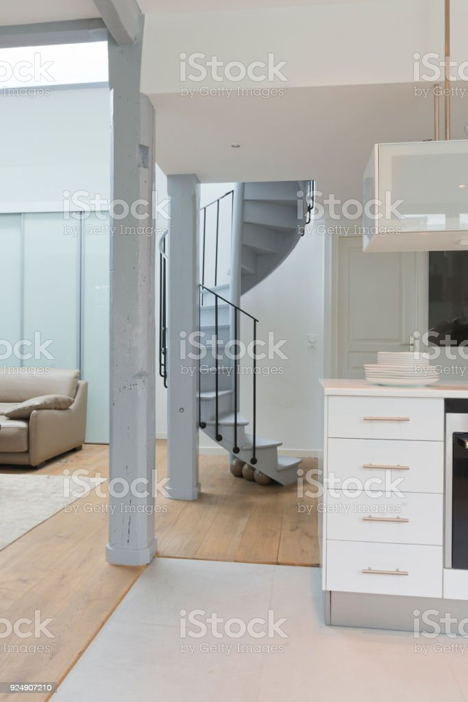 Wide Angle Of Living Space And Kitchen With Spiral Staircase. Royalty Free  Stock Photo