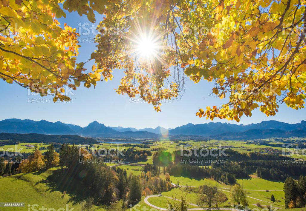 wide angle panoramic view to rural landscape in Bavaria with alps mountains stock photo