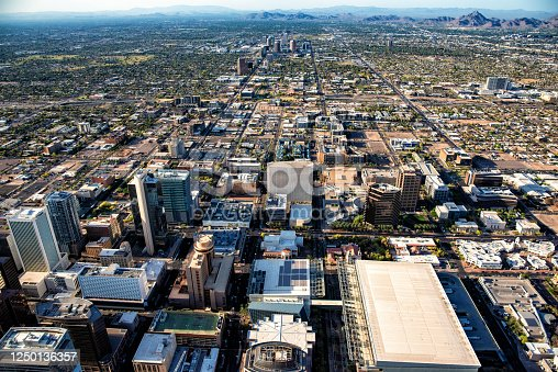 An aerial view of downtown Phoenix, Arizona and the surrounding urban communities from an altitude of about 1200 feet up.
