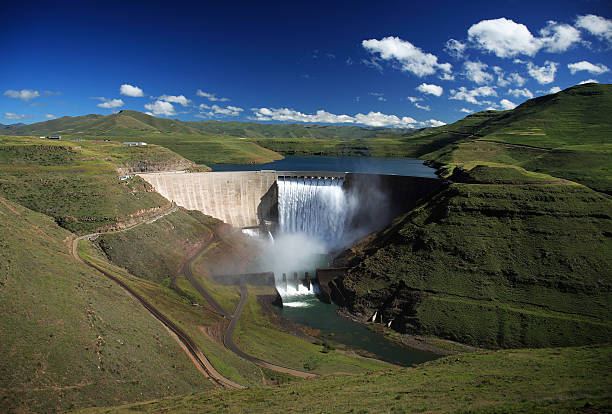 wide angle photo of the katse dam wall in lesotho - hydroelectric power stock photos and pictures