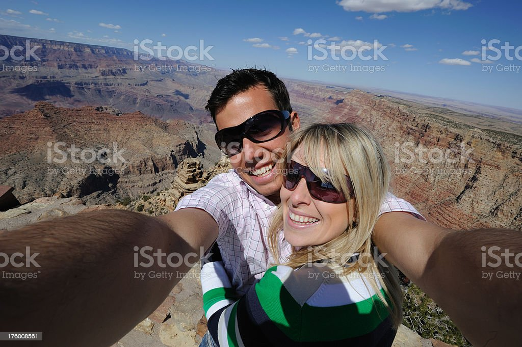Wide angle self portrait at the edge of Grand Canyon royalty-free stock photo