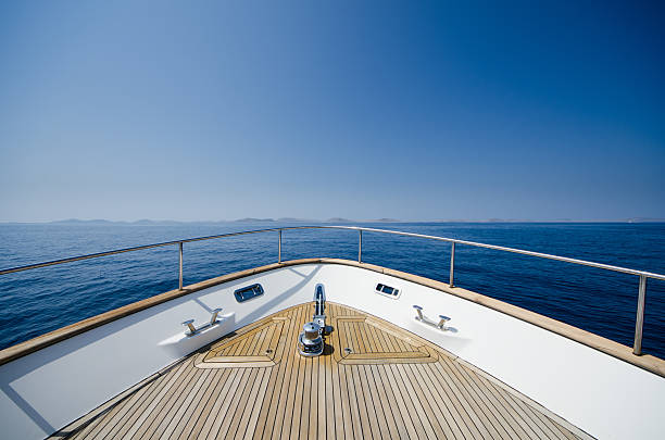 wide angle shot of front of the yacht - yacht front view stock photos and pictures