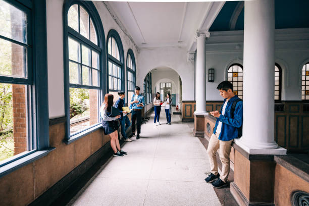 Wide angle shot of students and youth in lecture hall in East Asia. stock photo