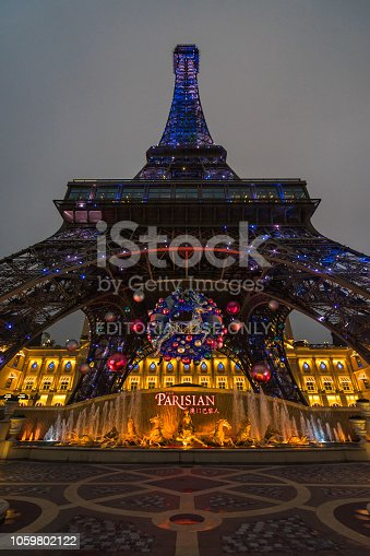 Wide angle view at night under Macau Eiffel Tower with Christmas decoration. Macau, January 2018