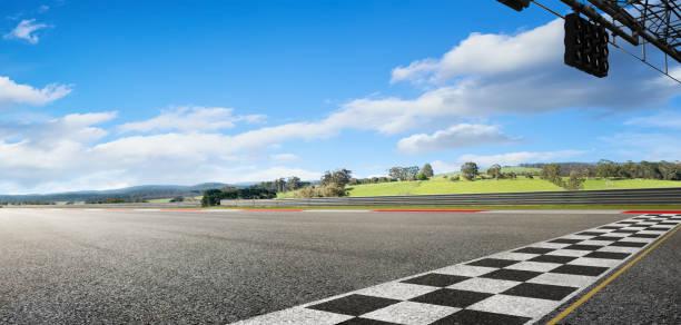 Wide angle view empty asphalt international race track stock photo