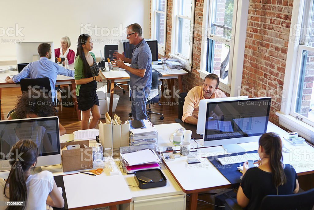 Wide Angle View Of Busy Design Office With Workers stock photo