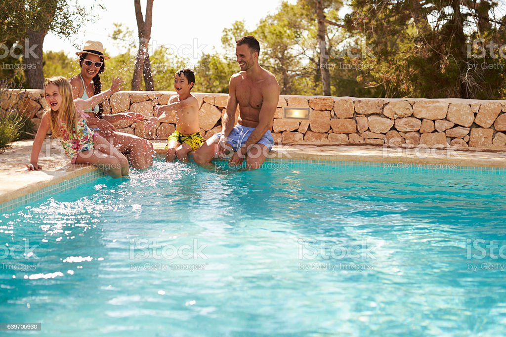 Wide Angle View Of Family On Vacation Having Fun By royalty-free stock photo