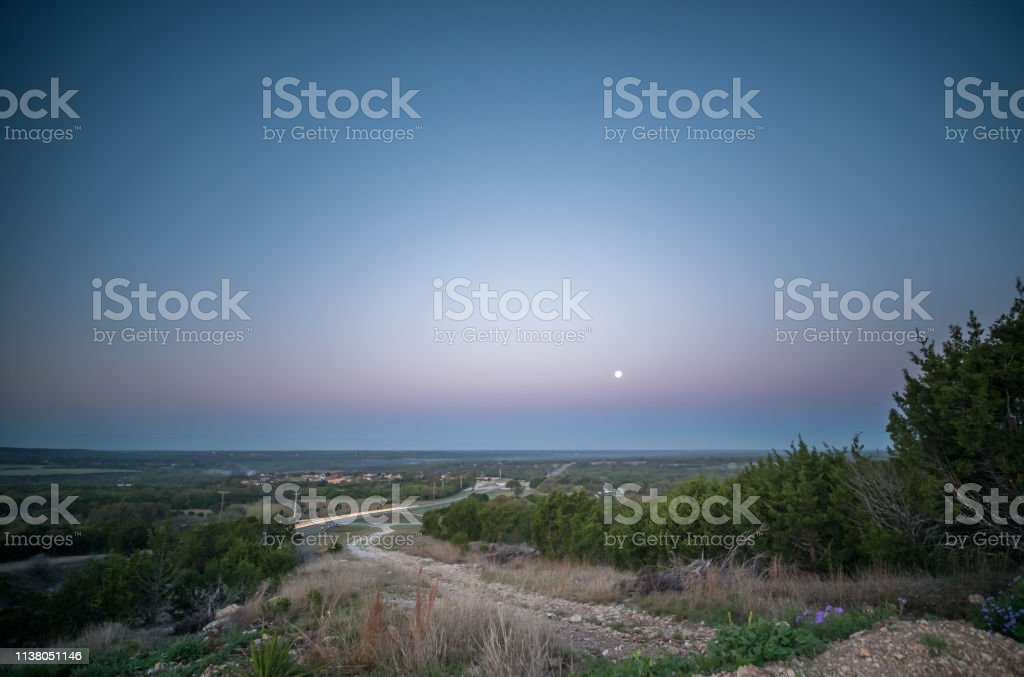 Wide Angle View of Full Moon Over Hill Country Valley During Early...