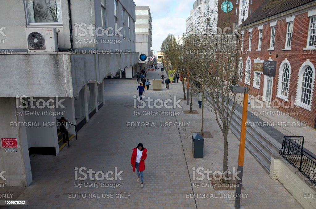 Bracknell, England - April 16, 2018: Wide angle view of old and modern buildings along the High Street with pedestrians, in the business and shopping district of Bracknell Town Centre, England stock photo