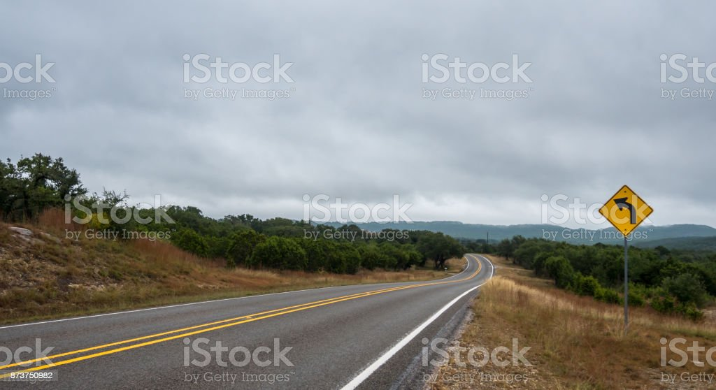 Wide Angle View of Road Curving Left In the Distance stock photo