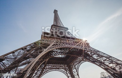 Paris, France - March 12, 2016: Low angle view of the Eiffel tower in Paris.