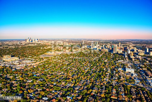 Wide angle view of the metropolitan area of Houston, Texas including the downtown skyline, the Houston Medical Center and the surrounding suburban neighborhoods shot from an altitude of about 1500 feet.