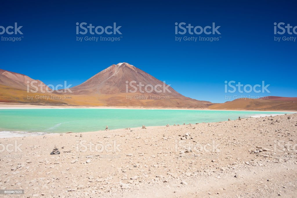 Wide angle view of the outstanding Green Lagoon or 'Laguna Verde', a frozen salt lake on the way to the famous Uyuni Salt Flat, travel destination in Bolivia. Snowcapped Licancabur Volcano, 5920 m, in the background. stock photo