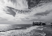 Wide angle view of the San Sebastian Beach, Sitges. Mediterranean sea in spanish coast. Black and white image
