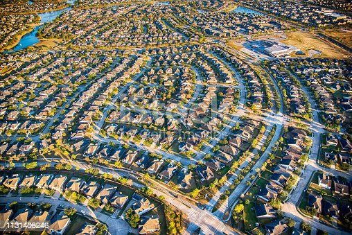 Aerial view of a large suburban development in a planned residential community in the suburban metropolitan Houston, Texas area.