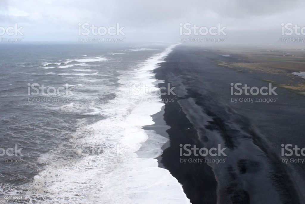 Wide beach of black sand in Dyrholaey area stock photo