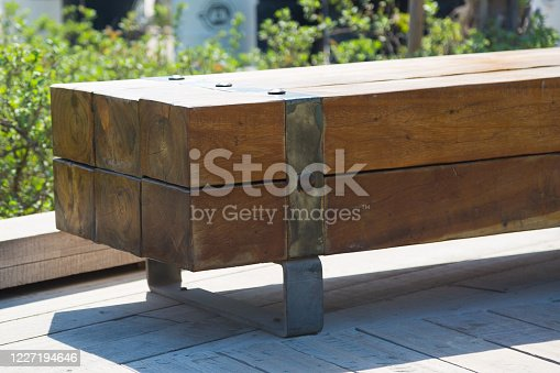 Vintage bench made of large thick logs.