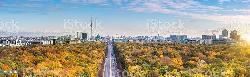 wide Berlin skyline over autumn colored  Tiergarten stock photo